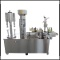 Semiautomatic bottling line for wine. Filler, corker, labeller and capsuling machine